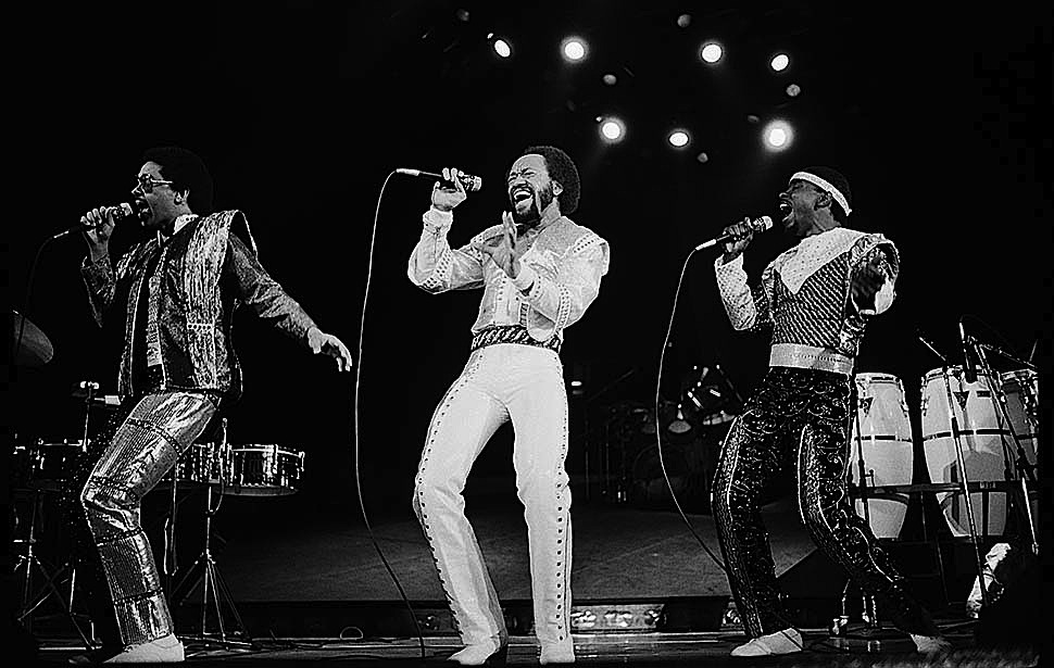 Dec. 21, 1981: Caption: Maurice Whie, center, leads Earth, Wind, & Fire in a Forum show that was marred by special effects.