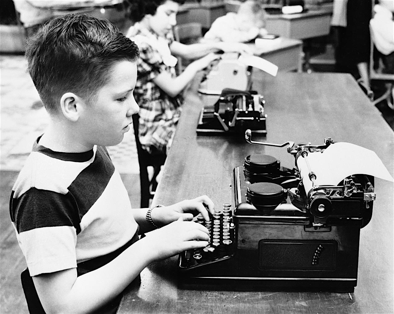 Boy and girl (6-7) using typewriters --- Image by © Bettmann/Corbis