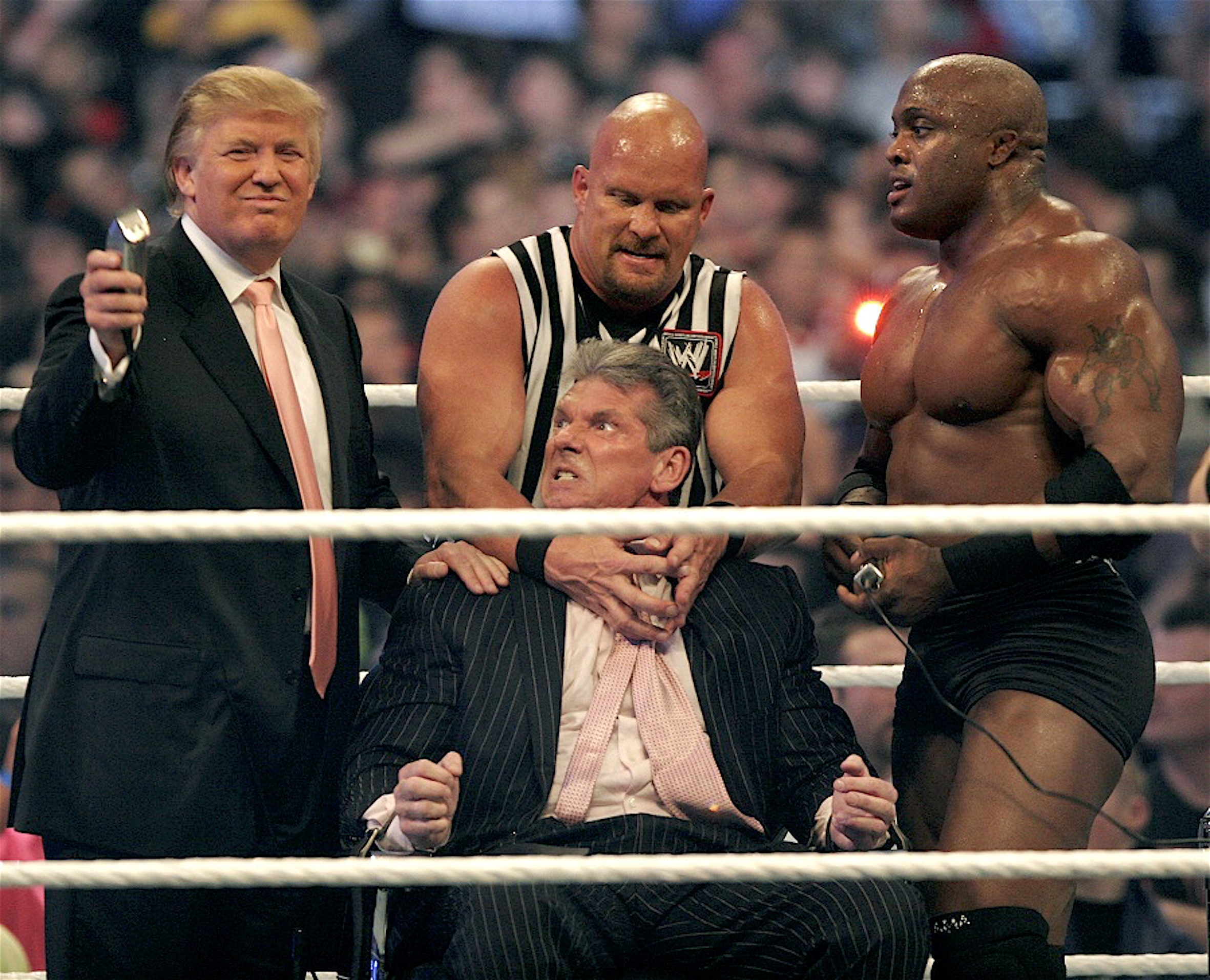 "DETROIT - APRIL 1: WWE chairman Vince McMahon gets held by Steve ""Stone Cold"" Austin while Donald Trump prepares to shave his head after losing a bet to Trump in the Battle of the Billionaires at the 2007 World Wrestling Entertainment's Wrestlemania April 1, 2007 at Ford Field in Detroit, Michigan. Umaga, who was representing McMahon in the match, lost to Bobby Lashley, who was representing Trump, so McMahon lost the bet. Lashley is standing on the right. The event drew more than 75,000 wrestling fans. (Photo by Bill Pugliano/Getty Images)"